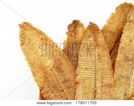 closeup spicy crispy squid isolated white background, snack and souvenirs from the sea