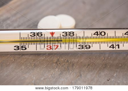 the thermometer with temperature in Celsius light background