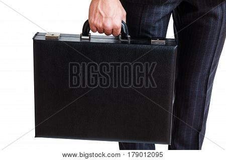 A Man In A Classic Suit Holds A Black Briefcase