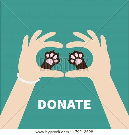 Two hands holding cute cat dog paw print. Love and care pet animals. Helping hand concept. Donate text. Flat design. Green background. Template. Vector illustration