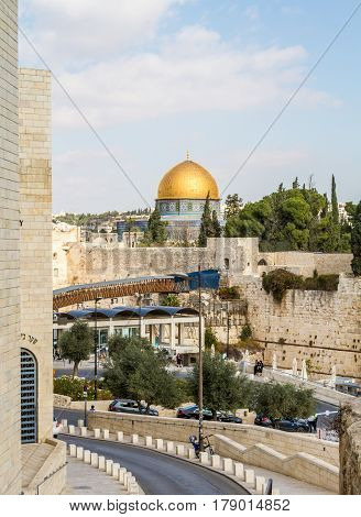 JERUSALEM ISRAEL - DECEMBER 8: The Western Wall the Dome of the Rock and the Mughrabi Gate on the Temple Mount view from the wall in the Old City of Jerusalem Israel on December 8 2016