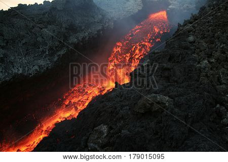 The lava flowing from Mt. Etna. .