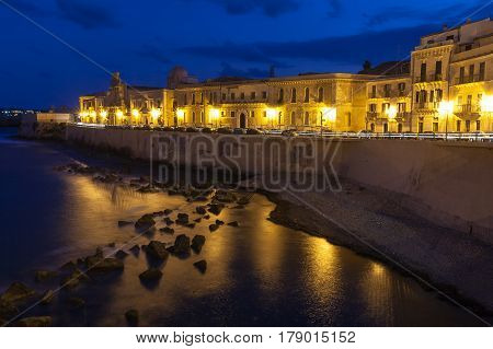Waterfront street and old buildings on the island of Ortygia the historic section of the Sicilian city of Syracuse.