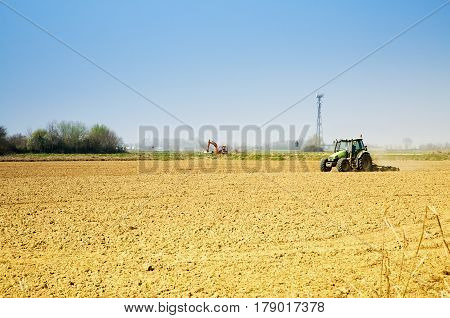 Tractor working in the fields horizontal image