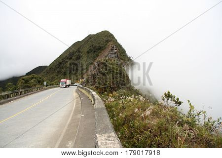 Truck at the mountain road in clouds, Yungas, Bolivia, South America