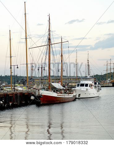 Oslo Norway - July 22 2014: Boats and yachts in Oslo harbor. The Oslo Norway harbor is one of Oslo's great attractions