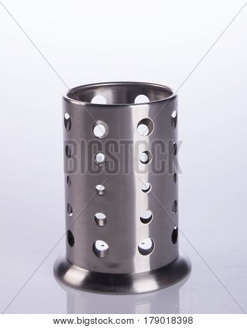 Kitchen utensils holder or utensils holder on the background.