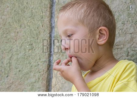 Boy pulls out of his mouth Apricot pits hands