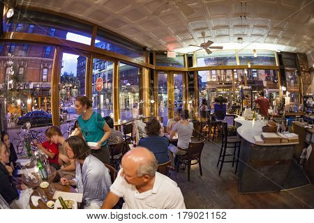 NEW YORK USA- JUL 9 2010: Tourists and local people enjoy the restaurant at the Orchard street in New York. The area was First known as Little Germany later a Jewish enclave.