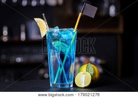 Blue Lagoon cocktail with a slice of lime and lemon