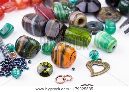 Semi-precious stone beads crystals glass and seedbeads for making jewelry. Selective focus.