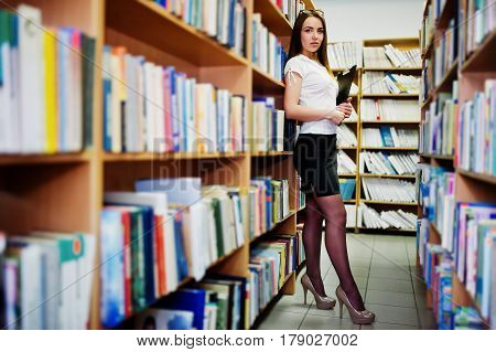 Brunette Girl At Library With Folder Of Documents, Wear On White Blouse And Black Mini Skirt. Sexy B