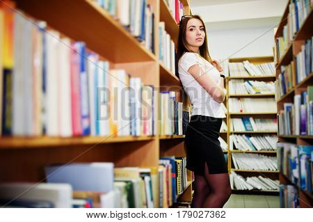 Brunette Girl At Library, Wear On White Blouse And Black Mini Skirt. Sexy Business Woman Or Teacher