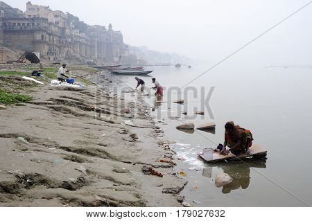 People Washing Clothes At Ghats On The Banks Of Ganges River