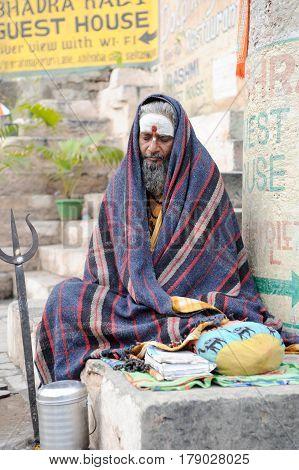 Holy Man In Meditation On A Ghat Of Varanasi