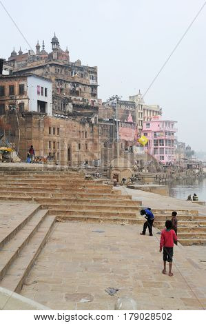 Boys Playing On The Ghats Of River Ganges