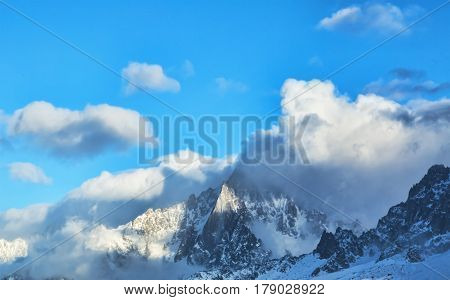 Impressive clouds formation over the high peaks in Alps in Mont Blanc Massif.
