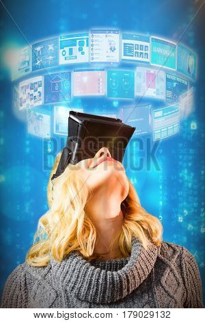 Happy blond woman using virtual reality headset against blue background 3d