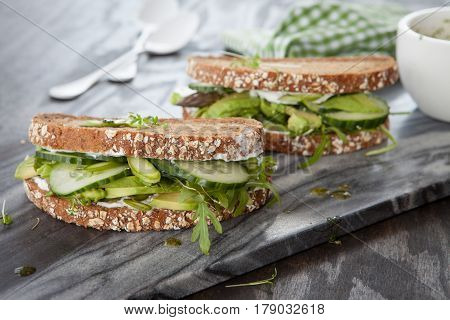 Whole wheat bread with fresh avocado and lettuce