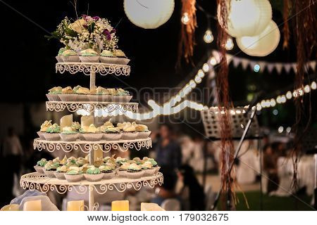 wedding cake at night with lighting candle.