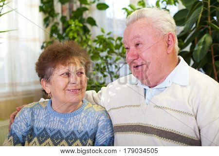 Picture of a happy elderly couple at home