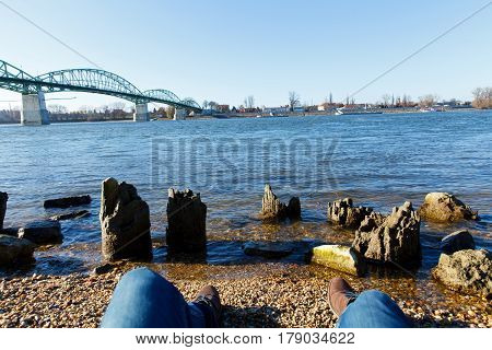 Picture of a young man's legs by the river of Danube