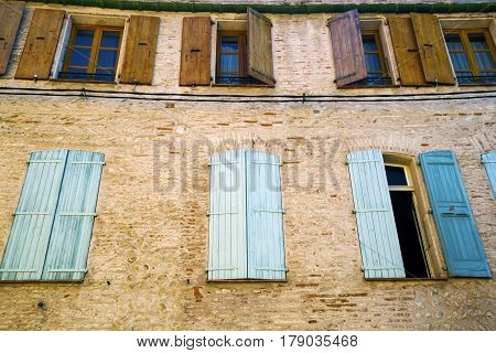 Detail of windows with blue shutters in the city center of the Perpignan in southeastern France
