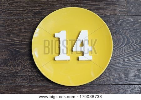 Figure fourteen on the yellow plate and brown background.
