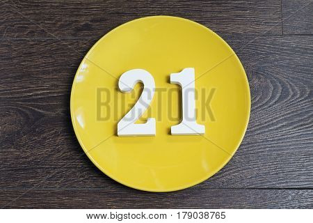 Figure twenty-one on the yellow plate and brown background.