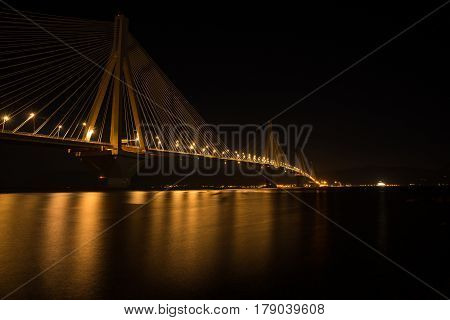 Nightscape of illuminated bridge over Korinthos bay, Greece