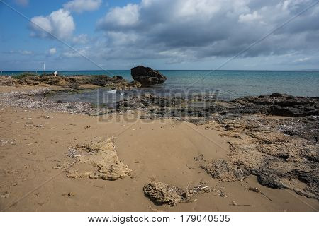 Rocky seaside landscape with cristal-clear turquoise water, Zalinthos island, Greece