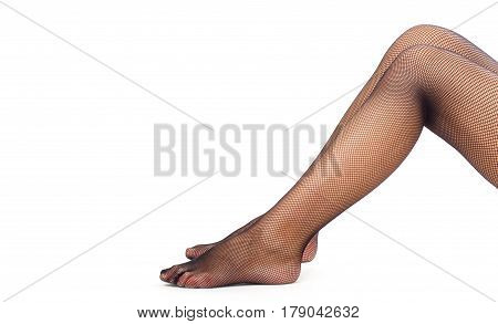 Woman legs with black fishnet tights. Isolated over white background