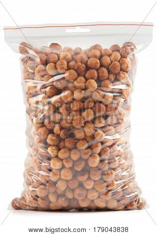 Hazelnuts in plastic zipper bag isolated on white