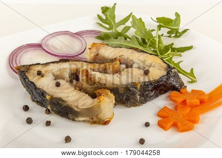 Prepared sturgeon. Dishes made from sturgeon. Grilled steaks of fish.