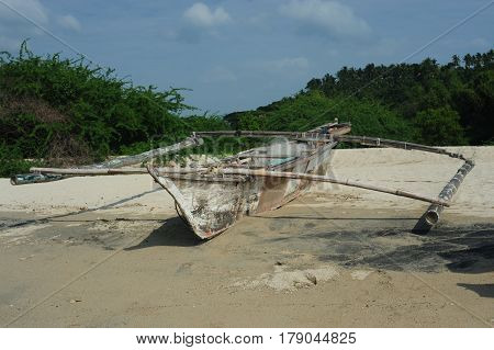 Old boat on the beach fisher web