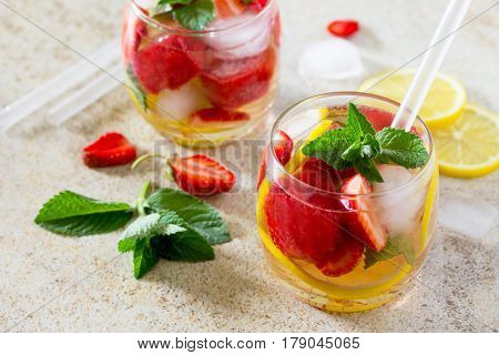 A Refreshing Summer Drink With Ice And Strawberries On A Stone Background. The Concept Of Eating Veg