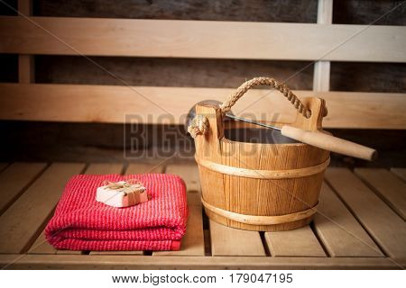 Water bucket, towel and soap in finnish sauna