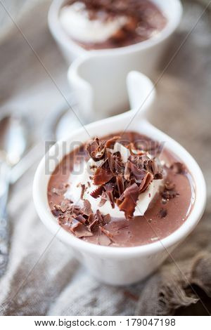 Chocolate pudding with whipped cream and chocolate