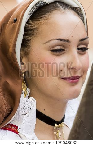 CAGLIARI, ITALY - May 1, 2014: 358 Religious Procession of Sant'Efisio - portrait of a beautiful girl in traditional Sardinian costume - Sardinia