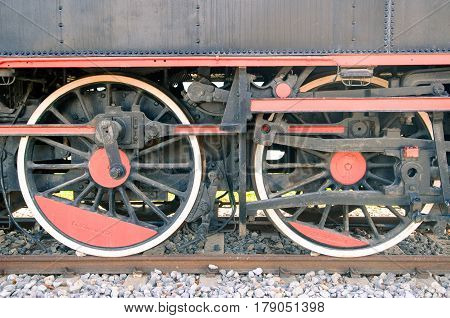 Close up of old steam locomotive wheels.