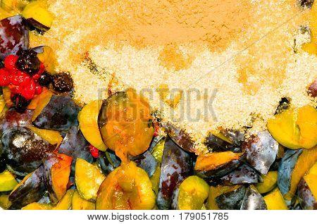 Close-up of homemade jam ingredients (plums, sugar, fruits).