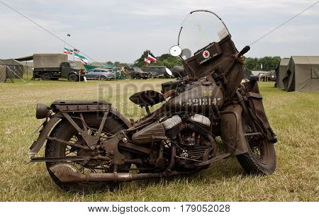 WESTERNHANGER, UK - JULY 20: A WW2 allies motorcycle stands on static display in one of the living history areas at the War & Peace Revival show on July 20, 2016 in Westernhanger