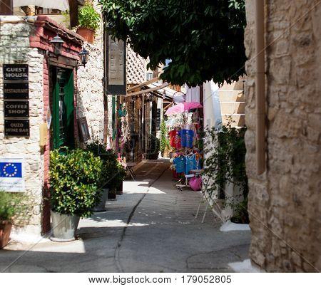 CYPRUS, OMODOS - 17-09-2015: Narrow street in old village Omodos, Cyprus