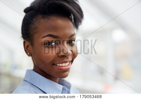 Adolescent girl looking at camera with smile