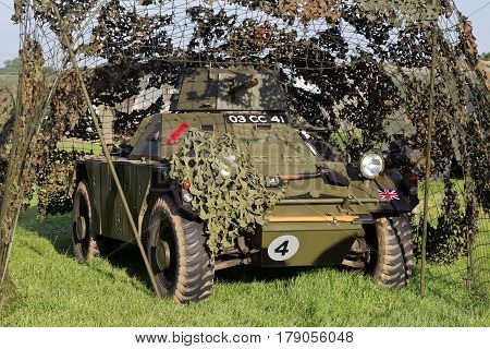 WESTERNHANGER, UK - JULY 21: A post war Daimler Ferret late of the British Army stands under camouflage nets for the public to view at the War & Peace Revival show on July 21, 2016 in Westernhanger