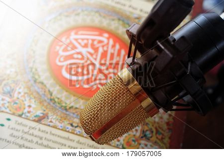 quran and microphone recite Islamic holy book arabic