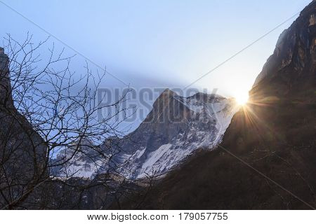 Himalaya Machapuchare mountain peak with sunrise behind on the way to Annapurna basecamp Nepal poster