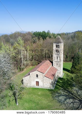 Aerial view of a old italian rural church. San Secondo is an antique small church (11th century), example of the Romanesque architecture in north Italy. Magnano, Piemonte, Italy.