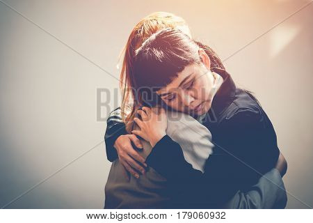 Two women hug to console, friendship concept