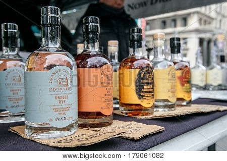 New York March 11 2017: Bottles of locally produces strong alcohol stand for sale at a farmer's market on Union Square.
